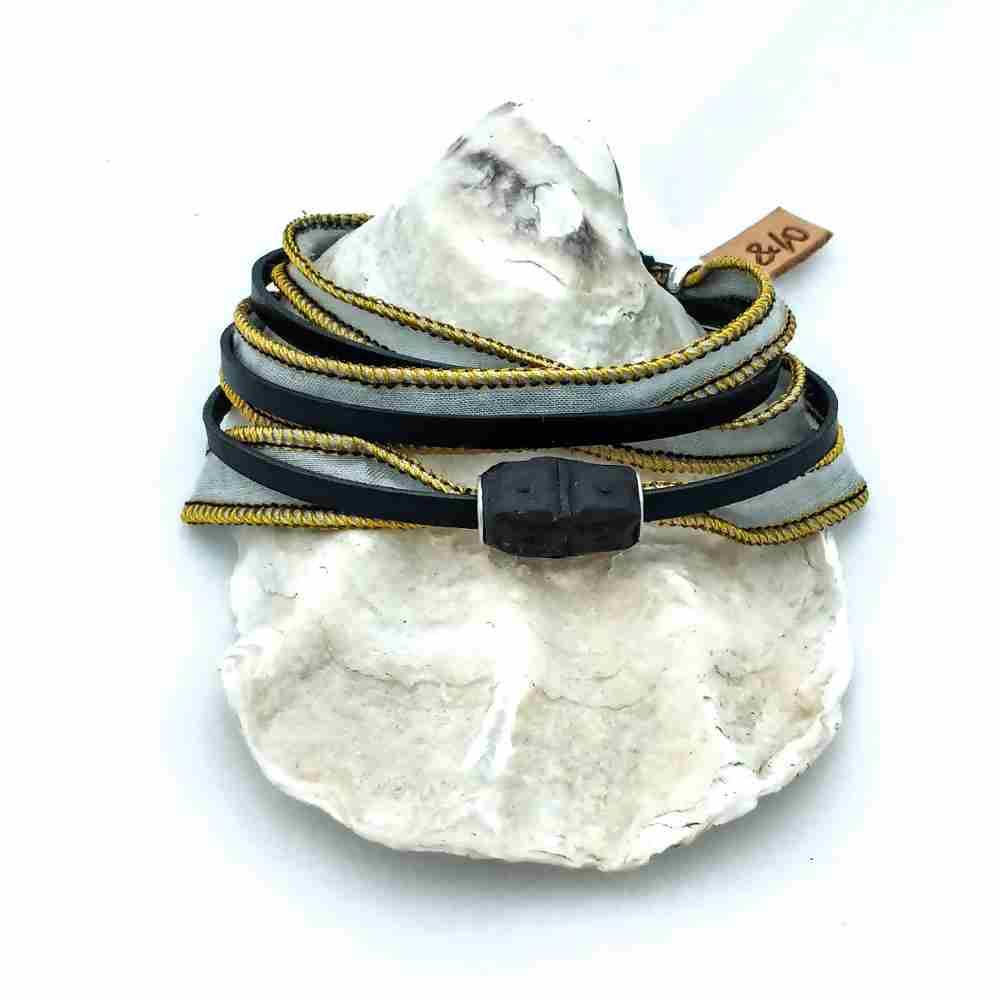 armband wikkel magneet geel zwart leer