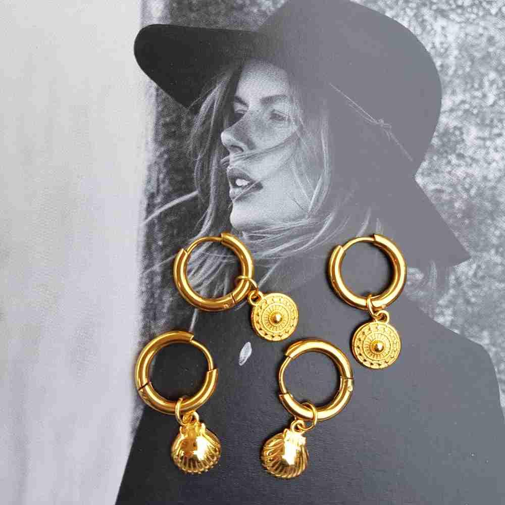 oorbellen goud ringen bedel